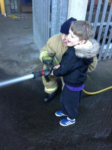 Caiden is a great aim with the fire hose!