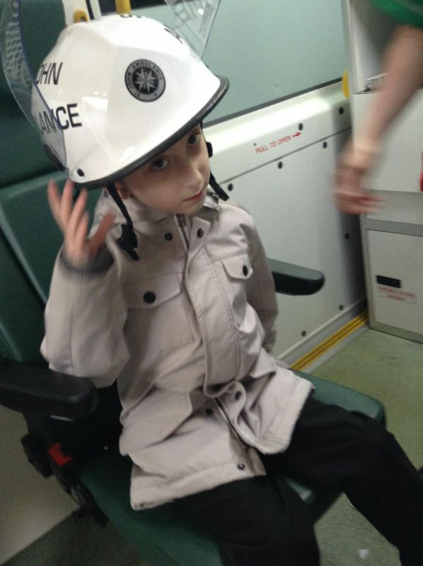 Corbin enjoyed trying on the first-aider's helmet, but it was very heavy!