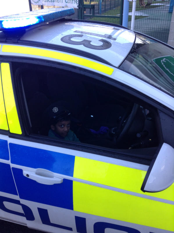 Abhiram driving off in the police car!