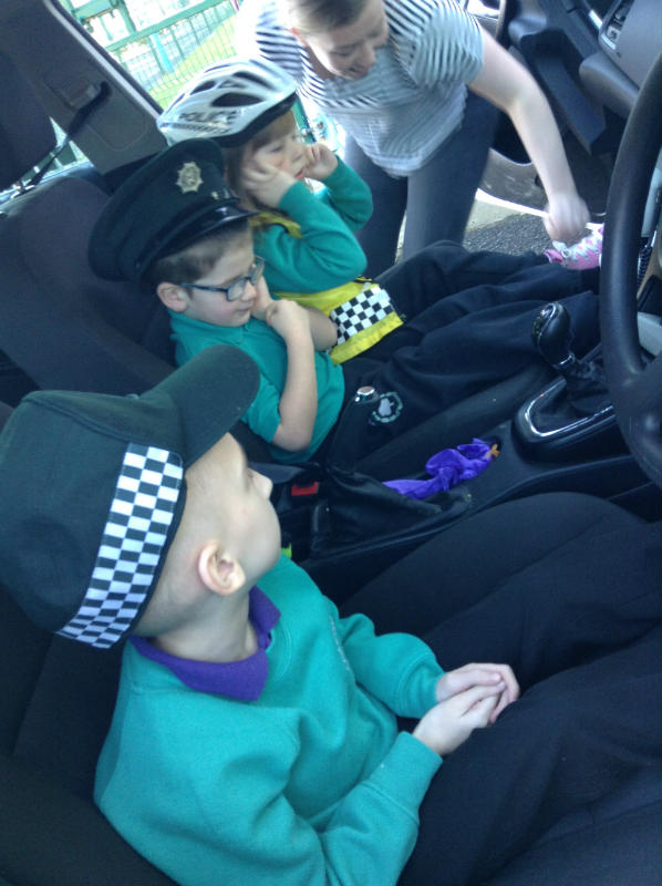 Pearse loved wearing the police hat and sitting in the police car...He had to cover his ears when he heard the siren!